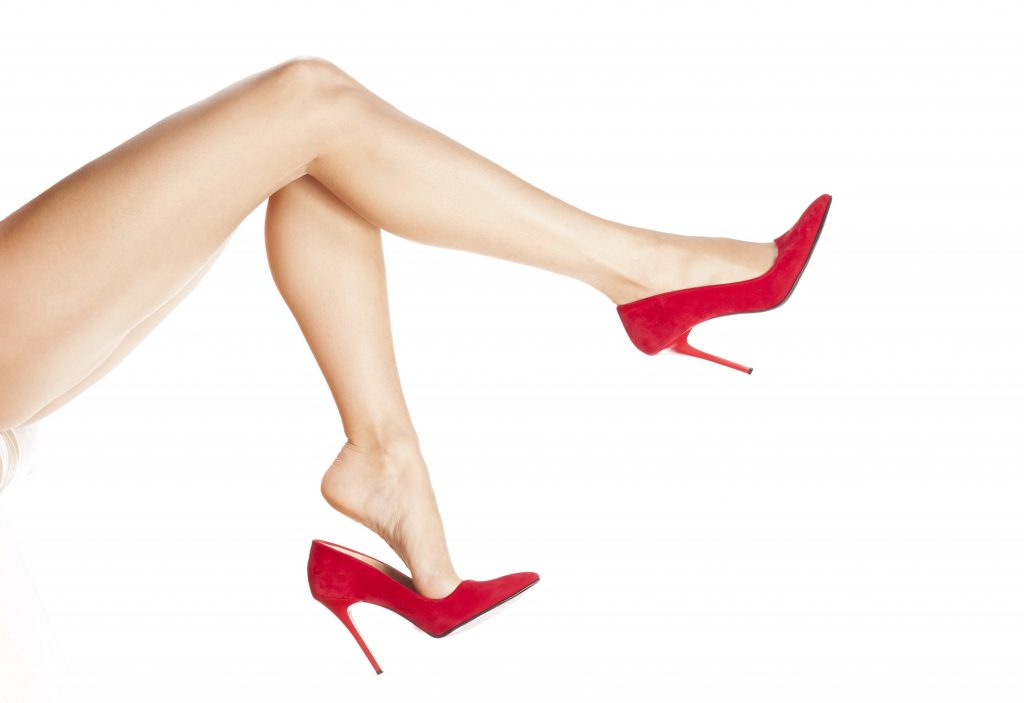 pretty female legs in red high heels
